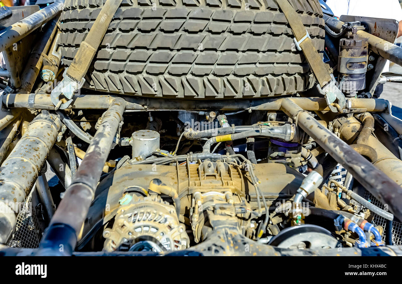 Car Engine in the back of an offroad vehicle dirty from the desert ...