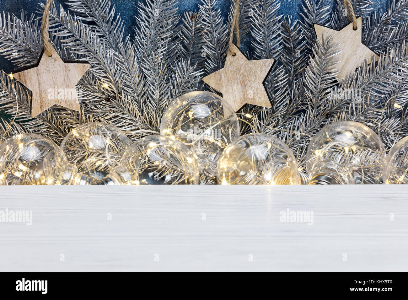 Silver Christmas Tree Branches Wooden Stars And Old Light Glowing