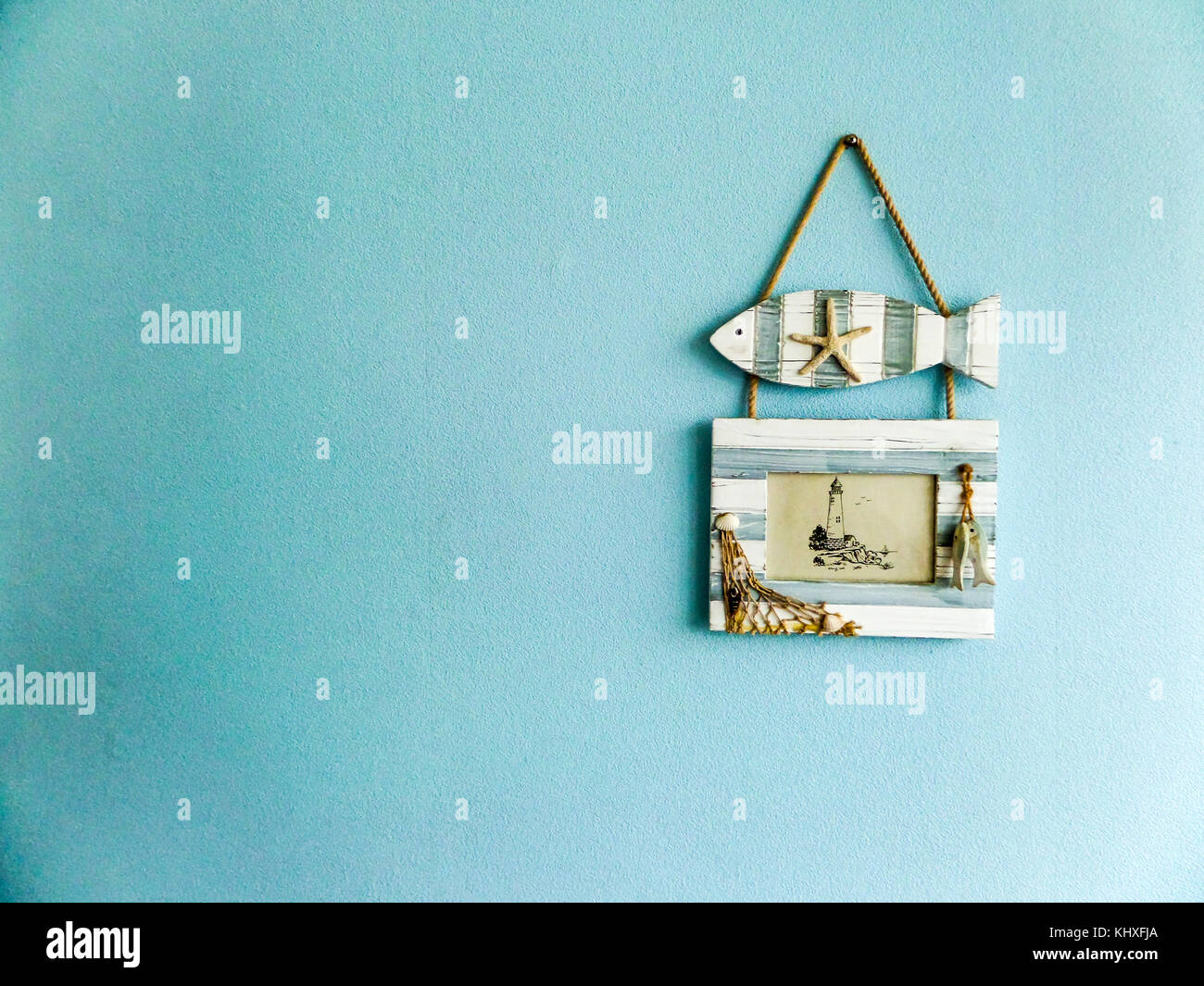 Fish and picture frame hang on aqua light color wall stock photo fish and picture frame hang on aqua light color wall jeuxipadfo Images