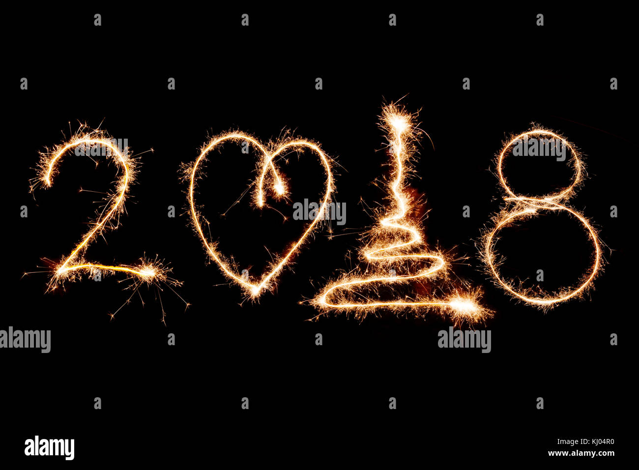 2018 written with sparkle firework on black background happy new year 2018 concept
