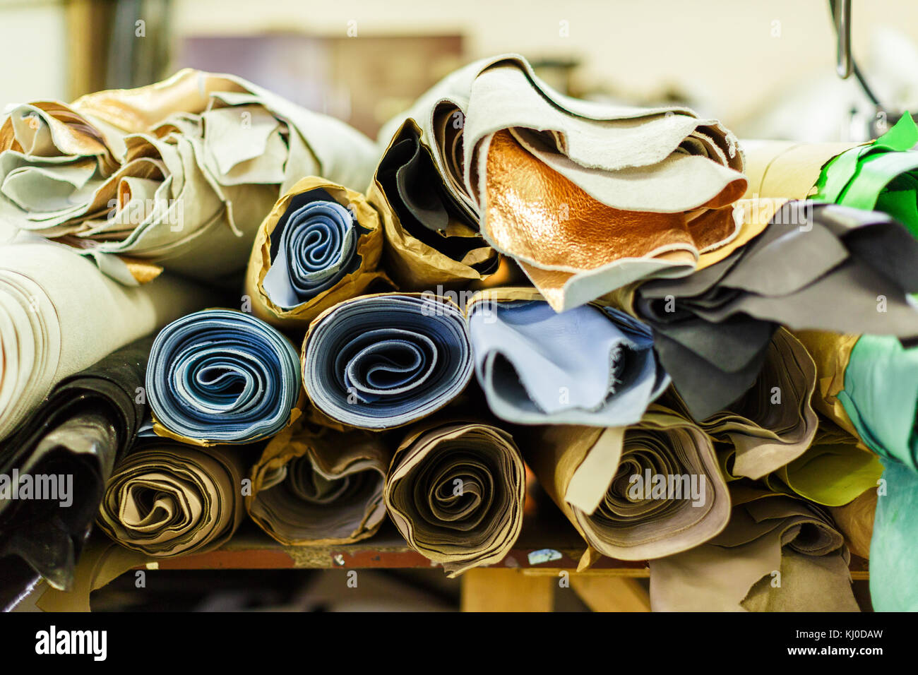 Rolls of fabric wrapped in craft paper lying on each other stock rolls of fabric wrapped in craft paper lying on each other manufacture close up photo jeuxipadfo Images
