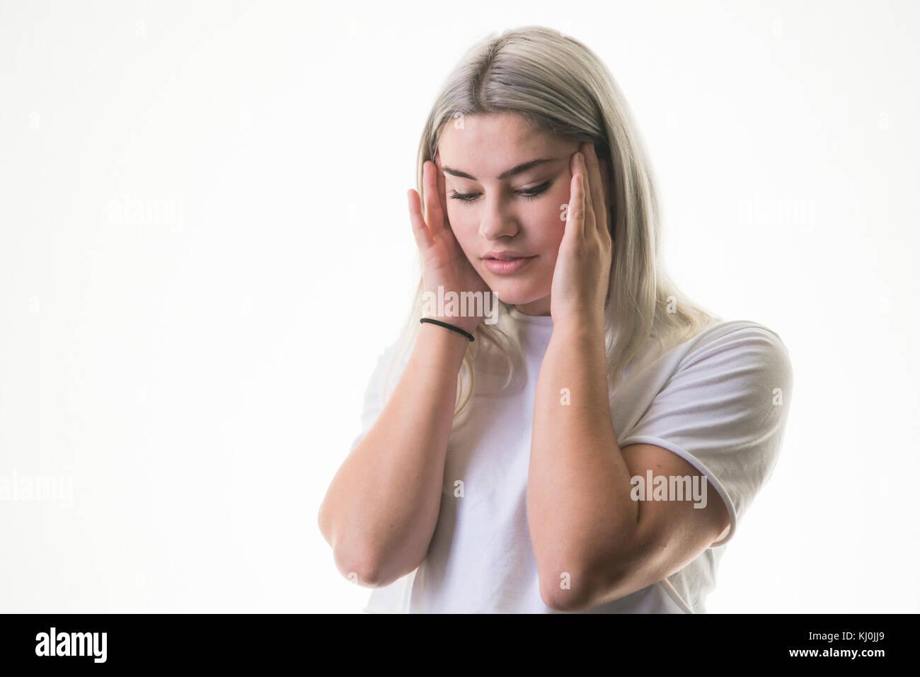 Teen girl rubbing her not present
