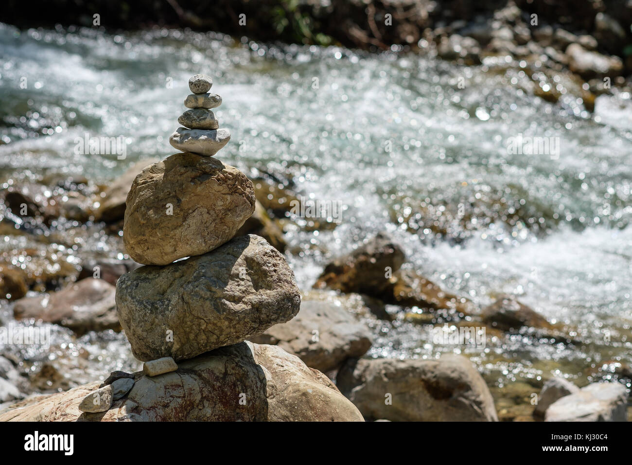 Cairns At A Mountain Stream As Symbol For Balance In Nature Stock