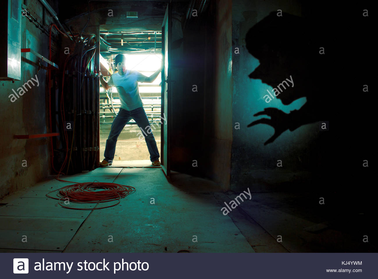 man in doorway with monster shadow stock photo 166066816 alamy