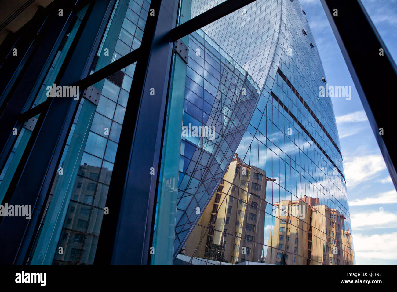Disappearing Glass Office Buildings In The Morning Wide: High Rise Office Building Exterior Skyscraper Stock Photos