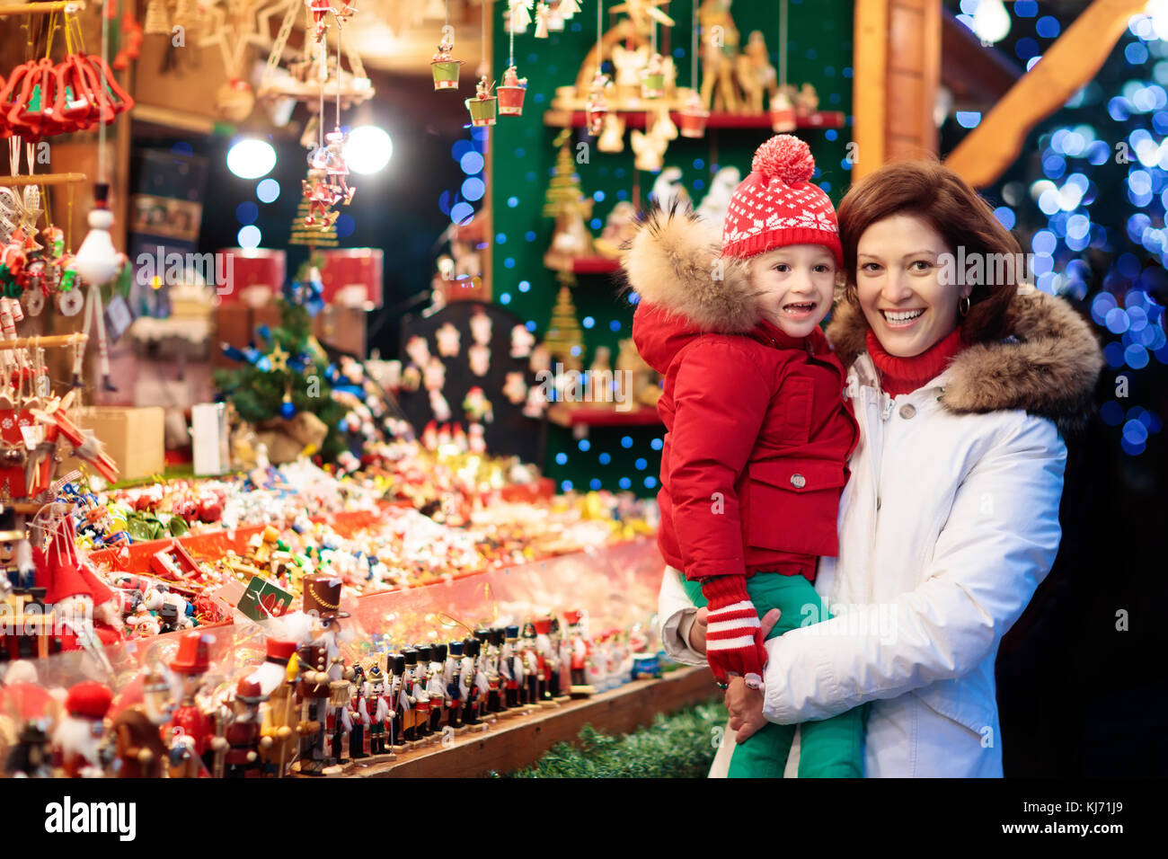 Traditional German Christmas Tree Ornaments Part - 18: Mother And Child In Warm Hat Watching Handmade Glass Christmas Tree  Ornaments At Traditional German Xmas Street Market. Family With Child  Shopping For