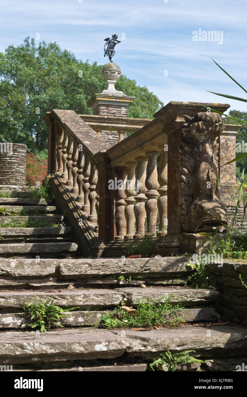 Ornate stone staircase and ornaments in the informal gardens of ...