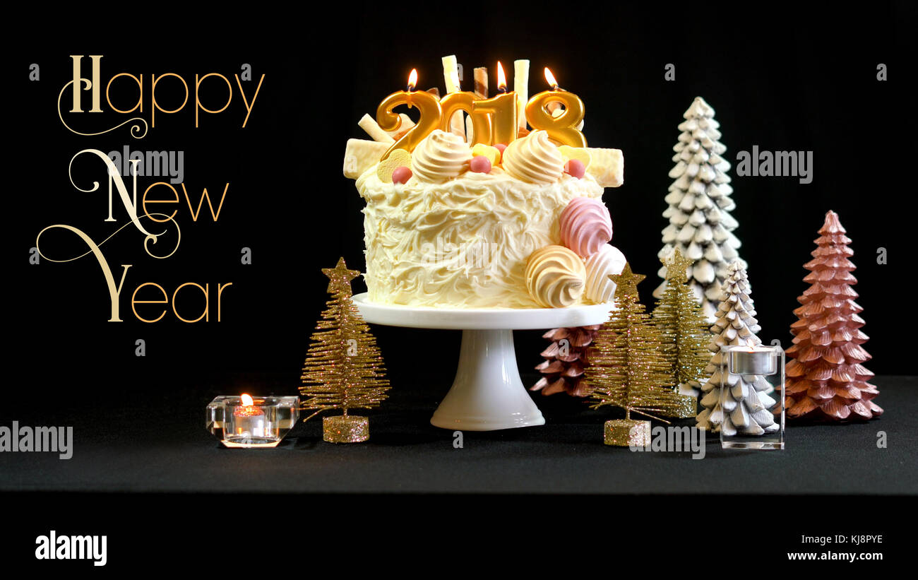 2018 happy new year showstopper cake decorated with white chocolate frosting cookies and candy centerpiece on a festive table