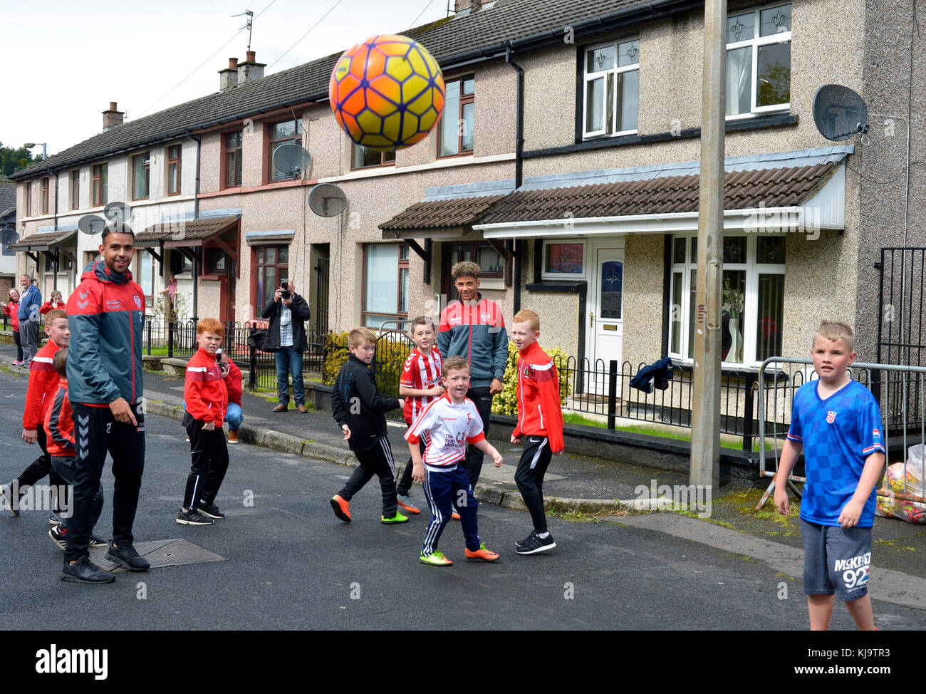 Children Play Football In The Street With Derry City Footballers