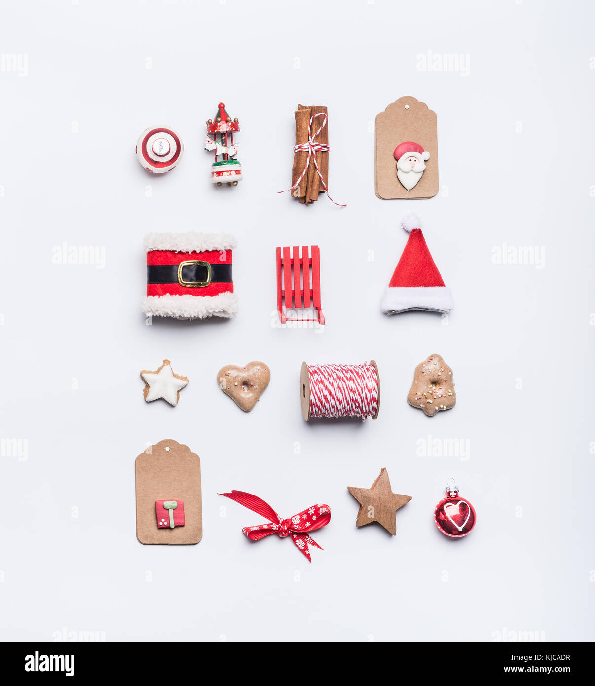 Creative christmas layout made of craft paper tags cookies red creative christmas layout made of craft paper tags cookies red christmas winter decoration santa hat sleigh cinnamon sticks on white desk backgro jeuxipadfo Choice Image