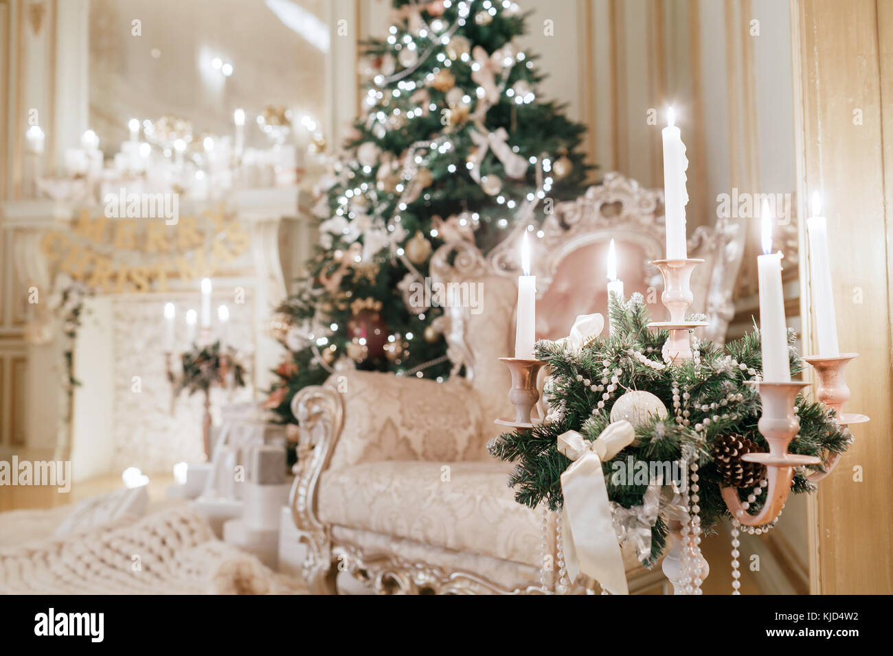 Chandelier christmas decoration stock photos chandelier the chandelier with candles in the foreground christmas evening classic apartments with a white arubaitofo Gallery