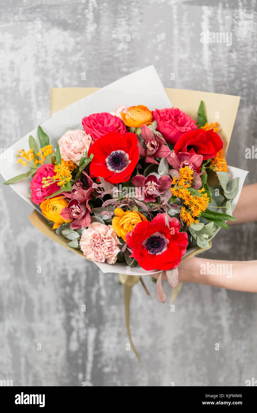 Beautiful luxury bouquet of mixed flowers in woman hand the work of beautiful luxury bouquet of mixed flowers in woman hand the work of the florist at a flower shop izmirmasajfo Choice Image
