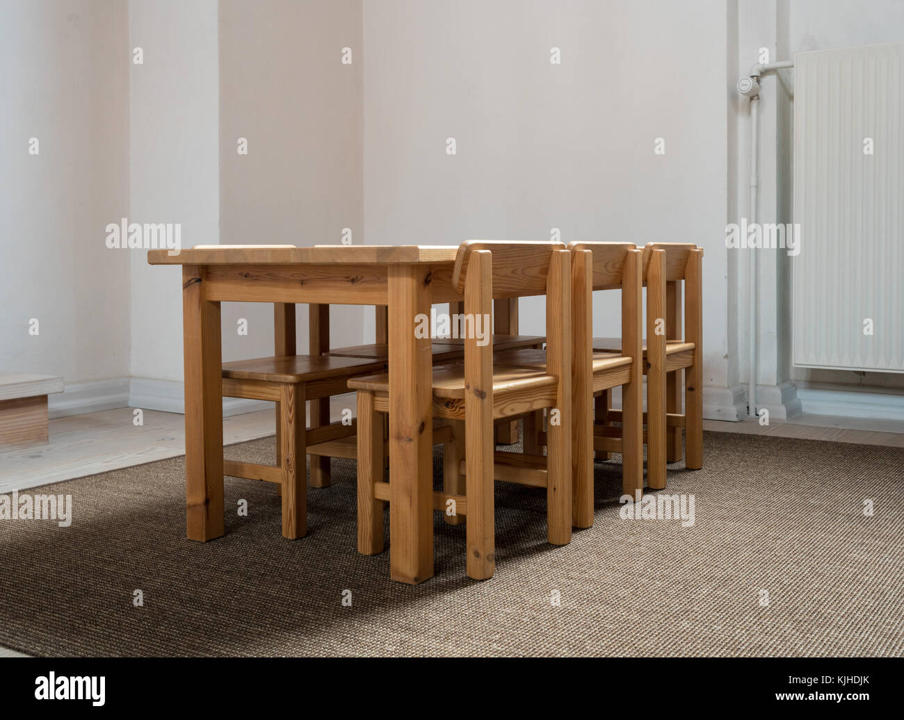 Child Sized Table And Six Chairs In Classroom