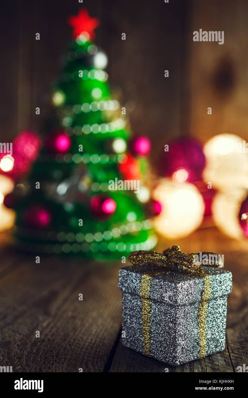 Christmas background with decorations and silver gift box on wooden ...