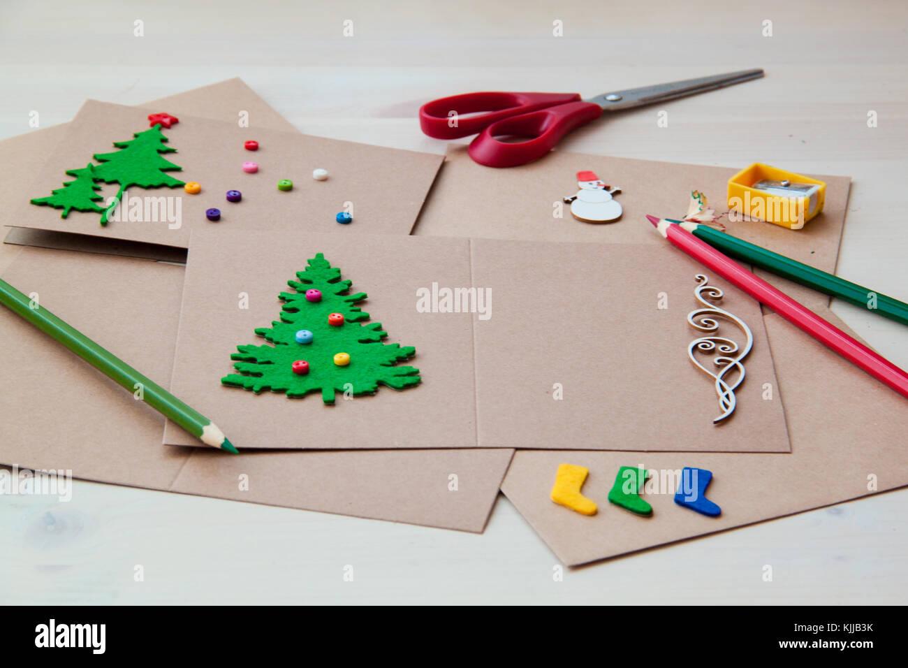 Signing Handmade Christmas cards. Felt, scissors, buttons Stock ...