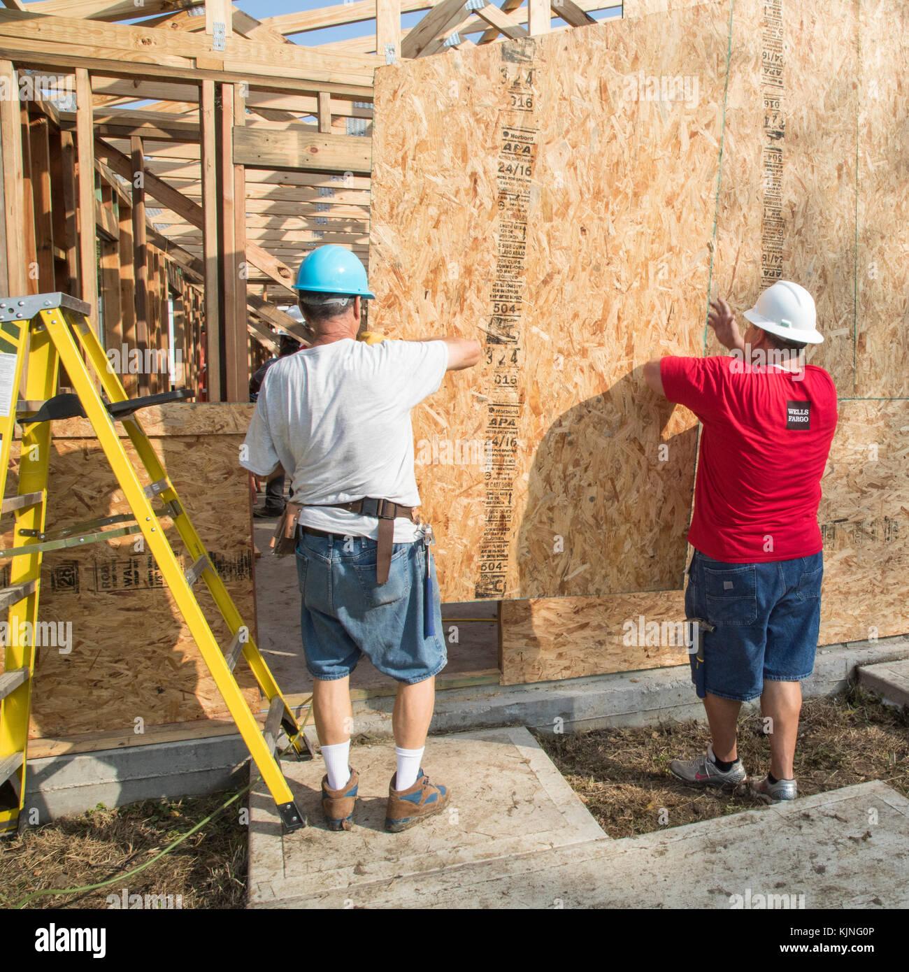 Houston, Texas - Volunteers from Wells Fargo Bank help build