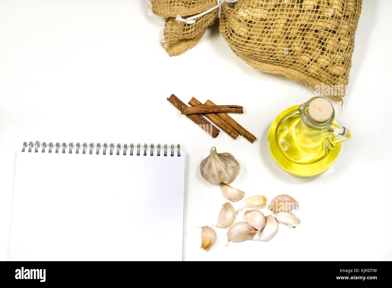 Notes to save the recipes on a white kitchen table. Seasonings Stock ...