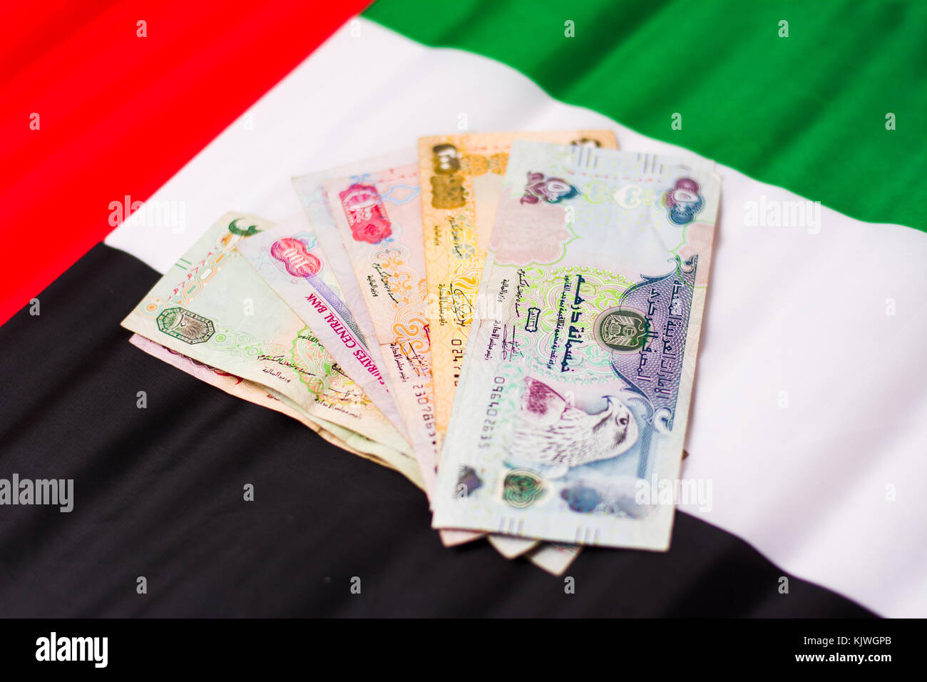 United arab emirates dirham banknotes on top of flag stock photo united arab emirates dirham banknotes on top of flag biocorpaavc