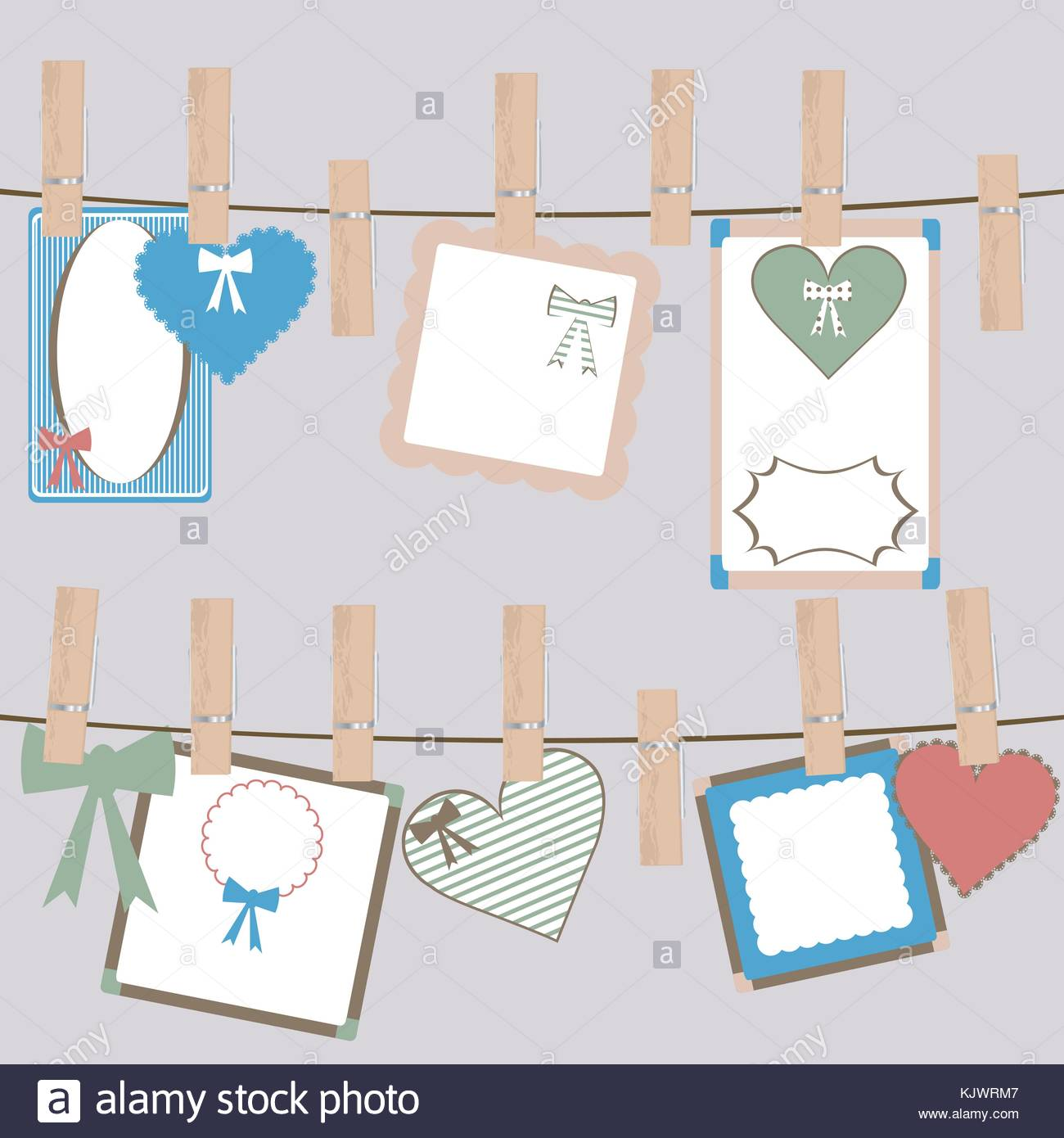 Set of cute frames and decorations hanging on a rope in cloth pegs ...