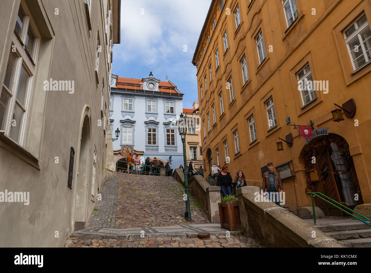 PRAGUE, CZECH REPUBLIC - APRIL 09, 2017: Tourists walking along streets of  old town at sunny day