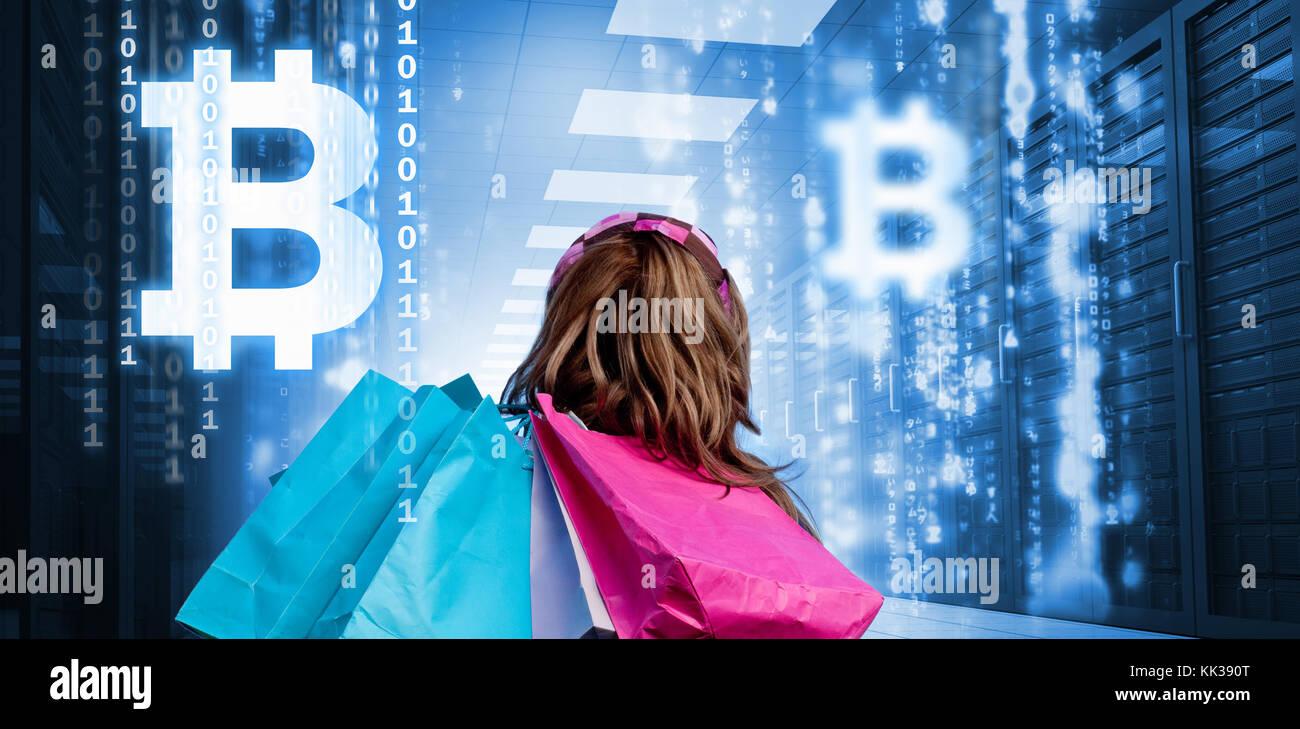 Symbol of bitcoin digital cryptocurrency against girl with symbol of bitcoin digital cryptocurrency against girl with shopping bags looking at falling matrix biocorpaavc