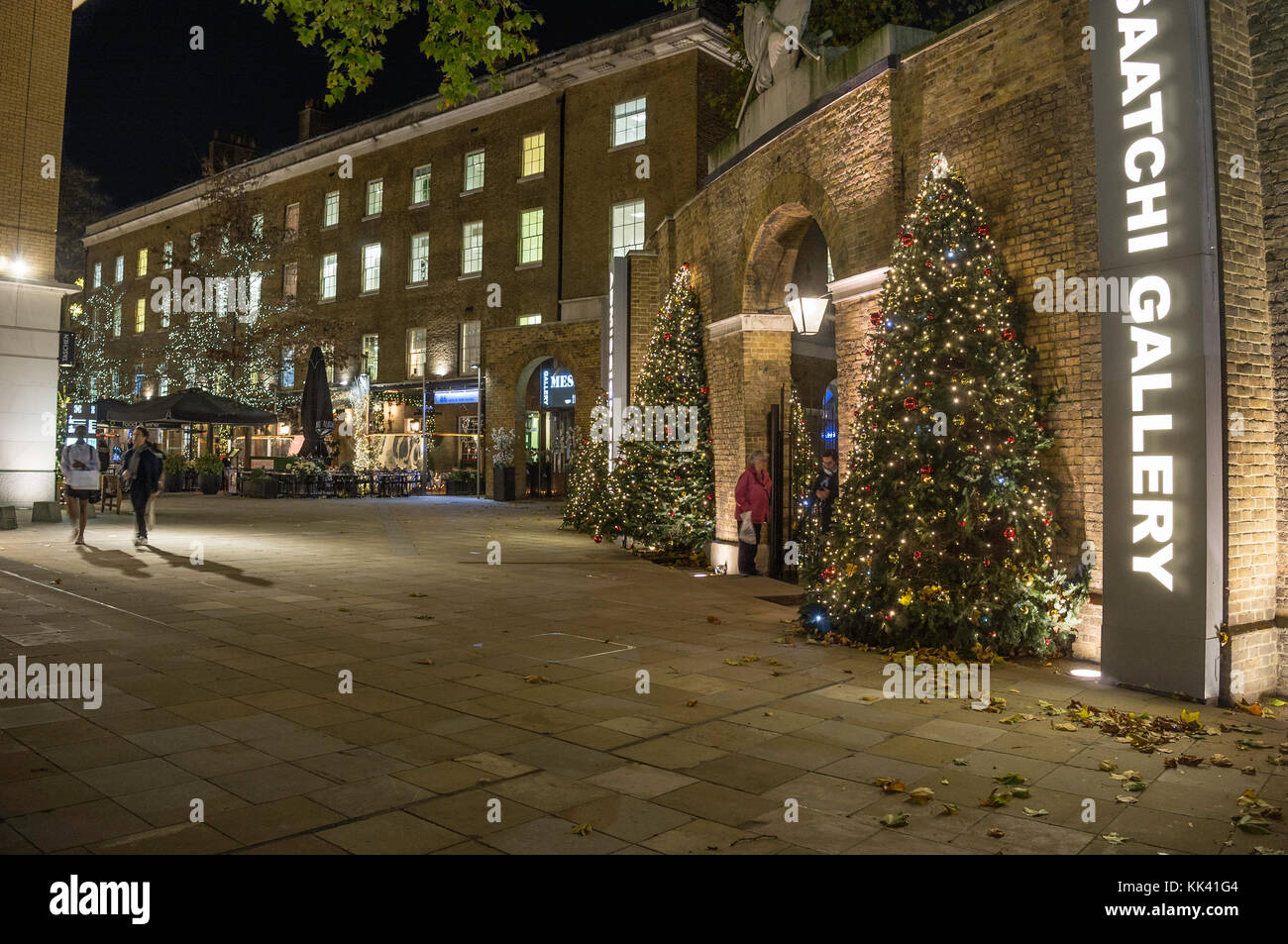 entrance to the saatchi gallery with christmas trees and lights