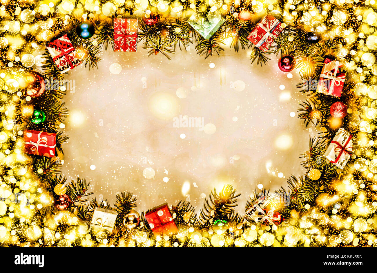 new year background frame of christmas tree branches and christmas decorations free space for text golden snow