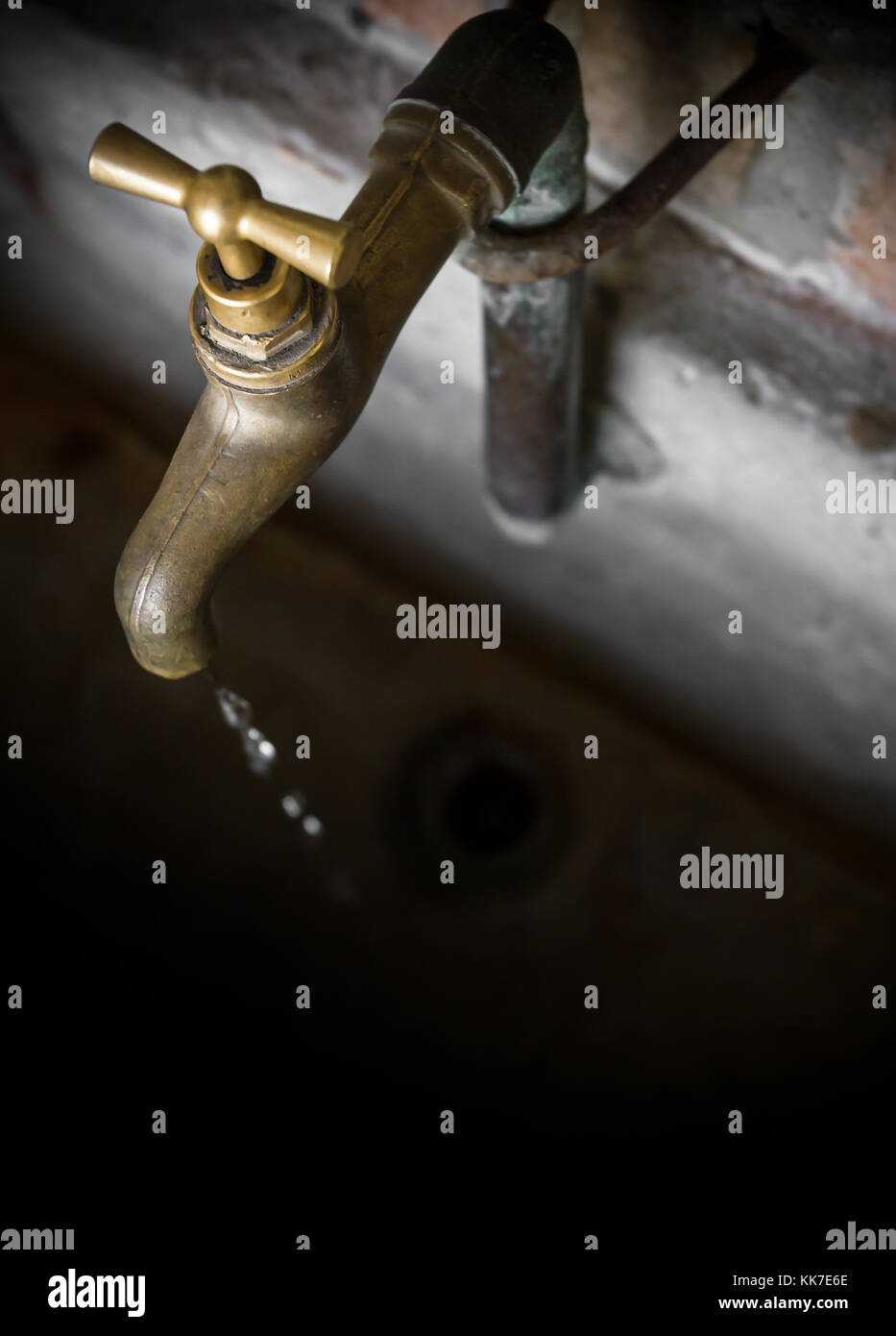 Old vintage brass water faucet, on ancient stone tub Stock Photo ...