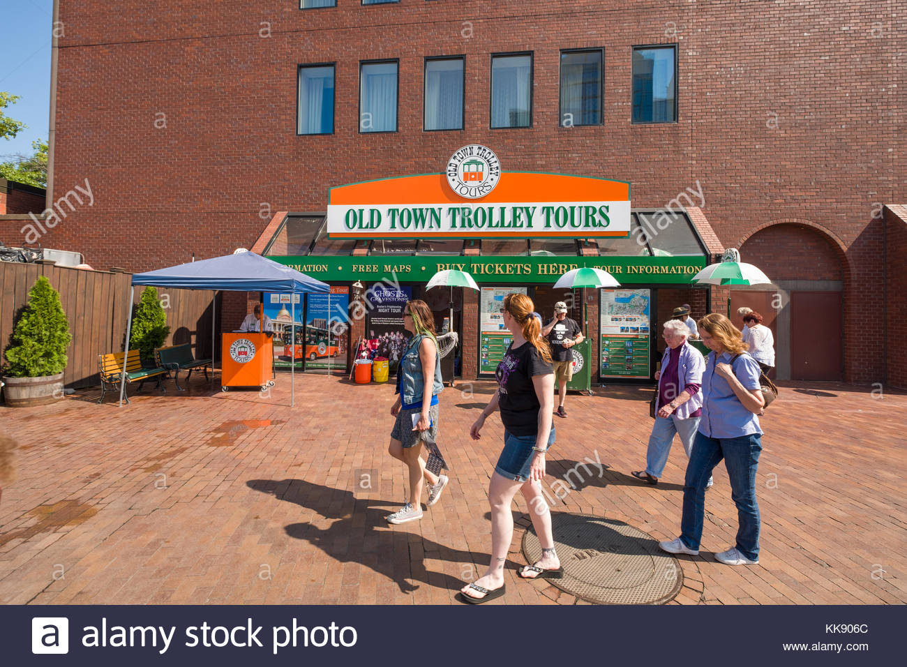 People Walking Past Old Town Trolley Tours Kiosk Boston Suffolk County Massachusetts