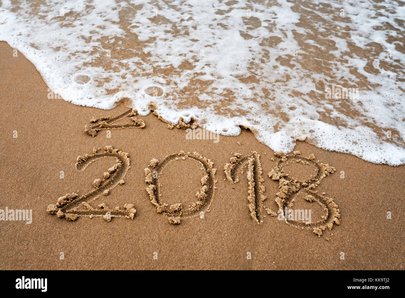 happy new year 2018 replace 2017 on the sea beach