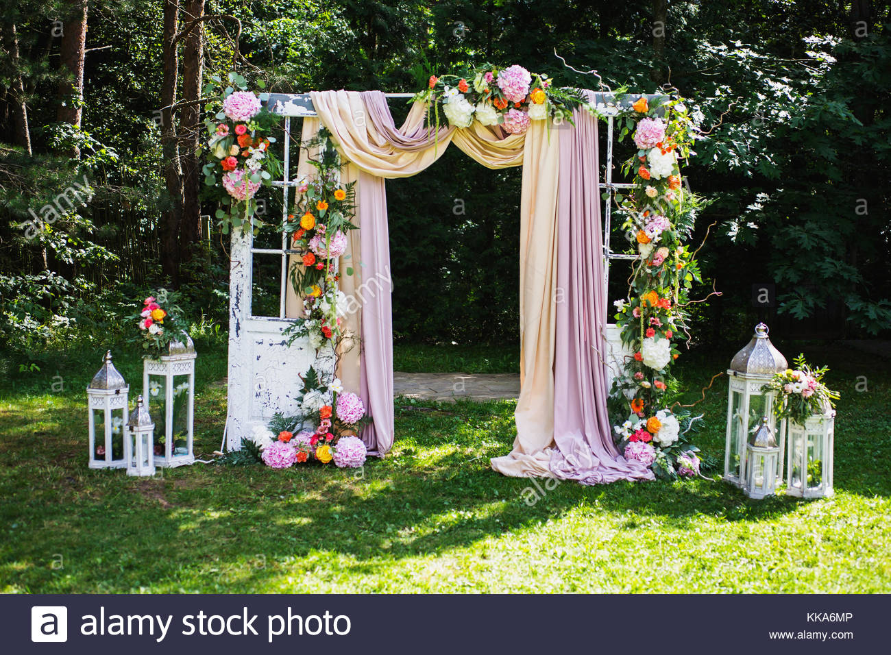 Beautiful wedding ceremony outdoors wedding arch made of cloth and beautiful wedding ceremony outdoors wedding arch made of cloth and white and pink flowers on a green natural background old doors rustic style junglespirit Image collections