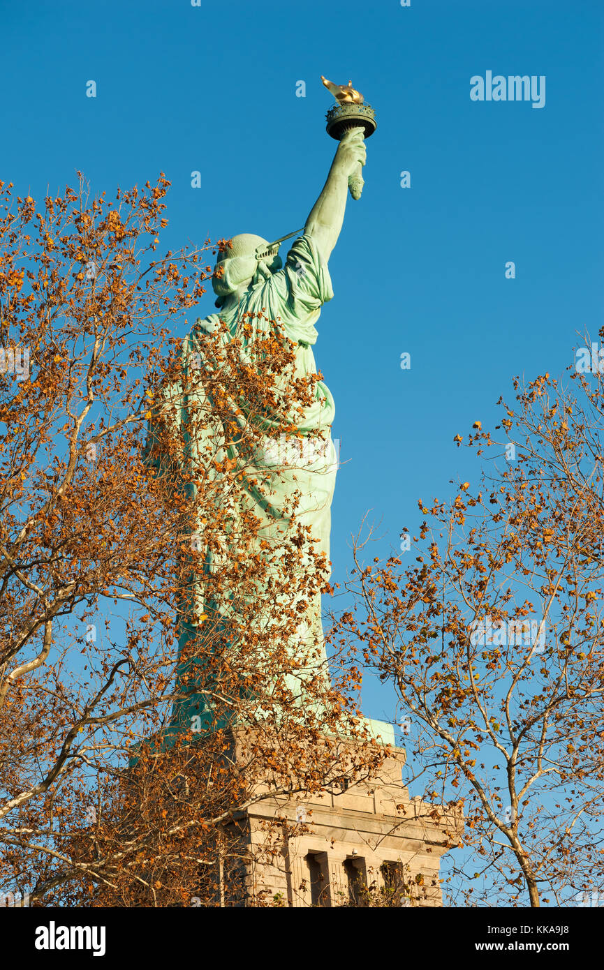 Statue of liberty crown view stock photos statue of liberty statue of liberty rear view against blue sky behind trees in aut stock image buycottarizona Gallery