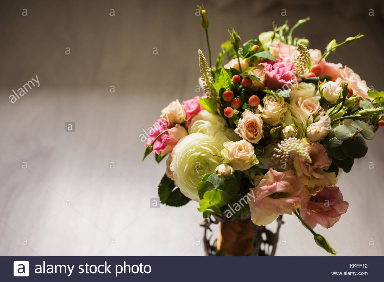 Wedding Bouquet Of White Red And Pink Flowers In A Vintage Vase