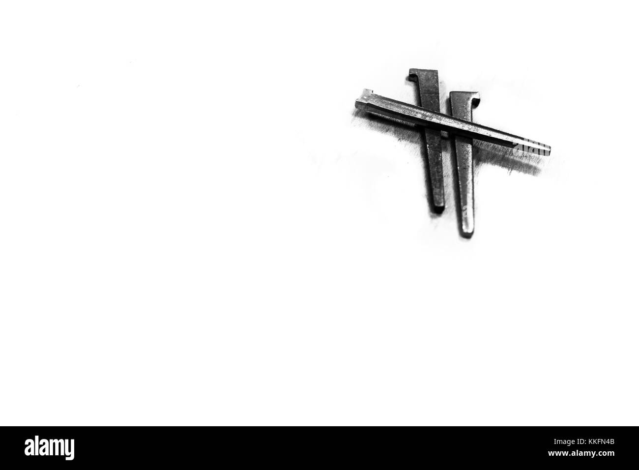 Symbolism black and white stock photos images alamy three iron spikes nails arranged in the shape of the cross of christ easter buycottarizona