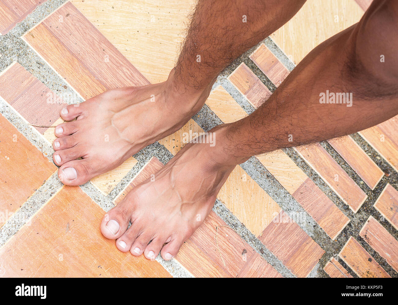 male bare feet on floor tile,The poor no money to buy shoes.(select ...