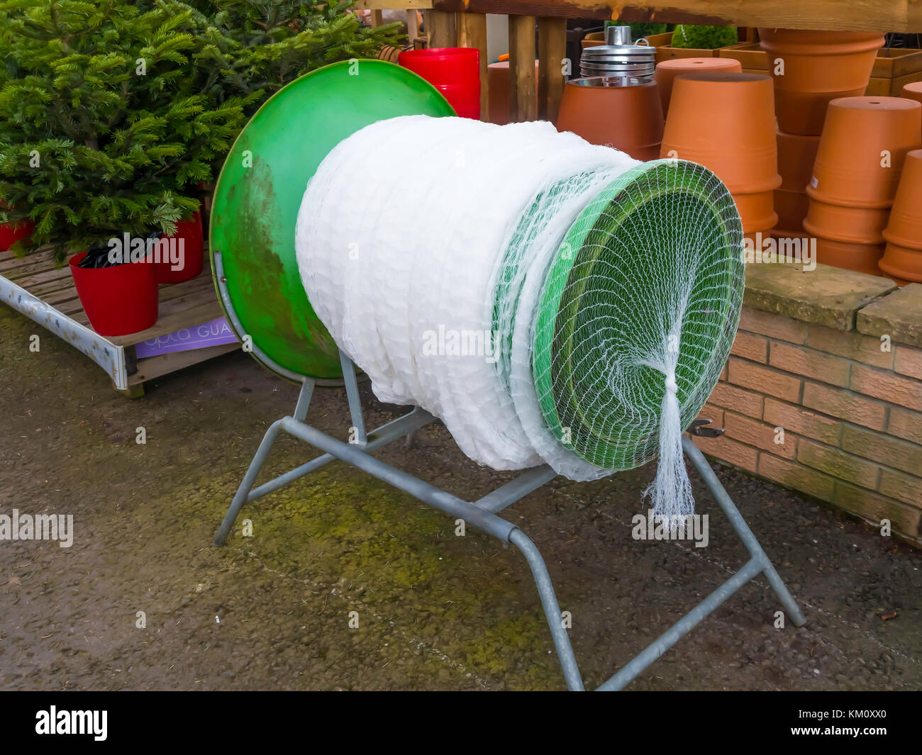 Exceptional A Green Christmas Tree Netting Funnel Ready For Use In A Garden Centre