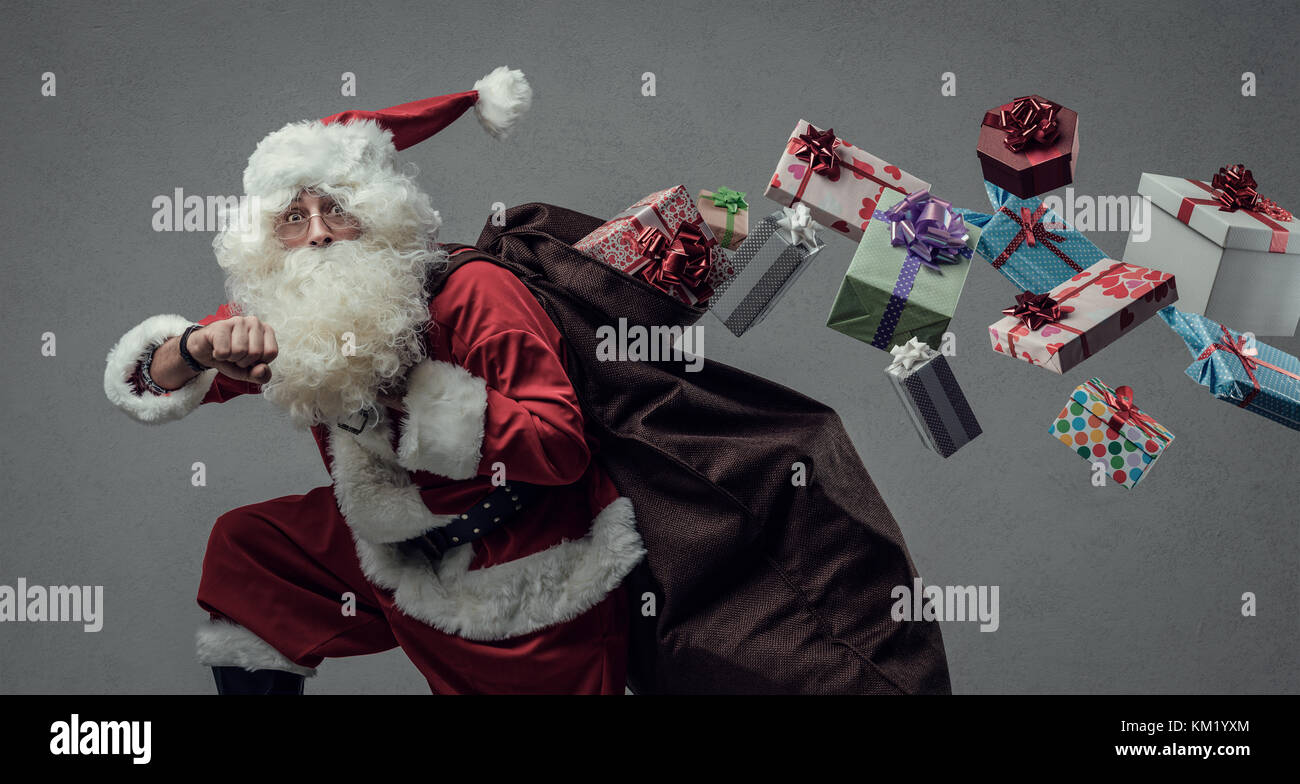 Funny Santa Claus running and delivering Christmas presents, he is ...