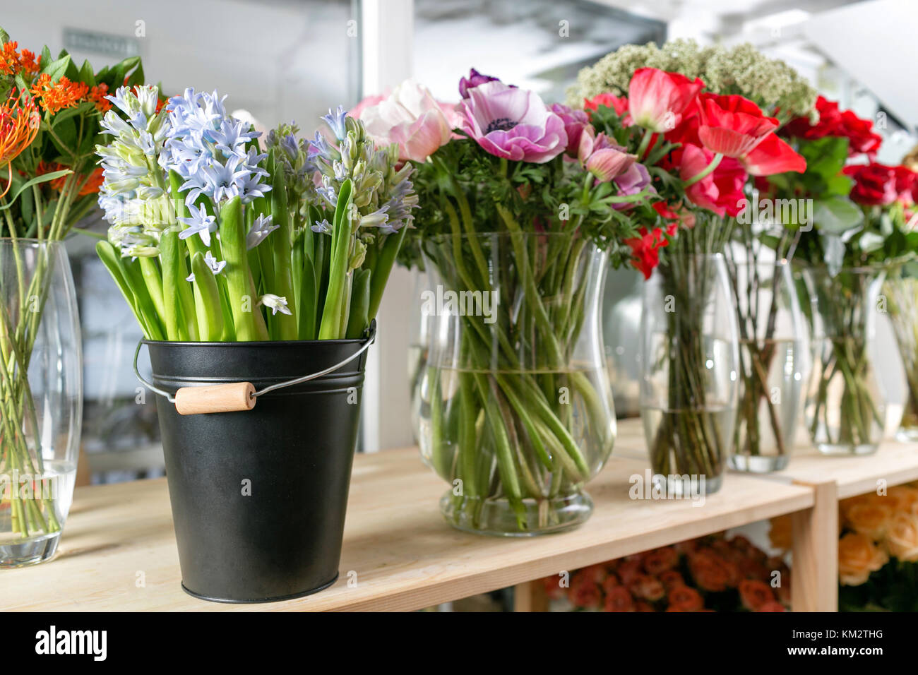 Different varieties fresh spring flowers in refrigerator for fresh spring flowers in refrigerator for flowers in flower shop bouquets on shelf florist business mightylinksfo
