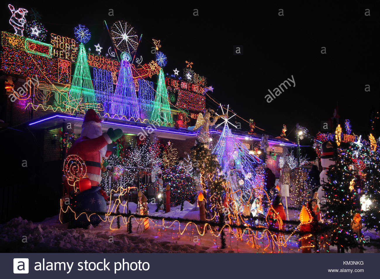 house decorated with a large amount of christmas lights and decorations in toronto ontario canada