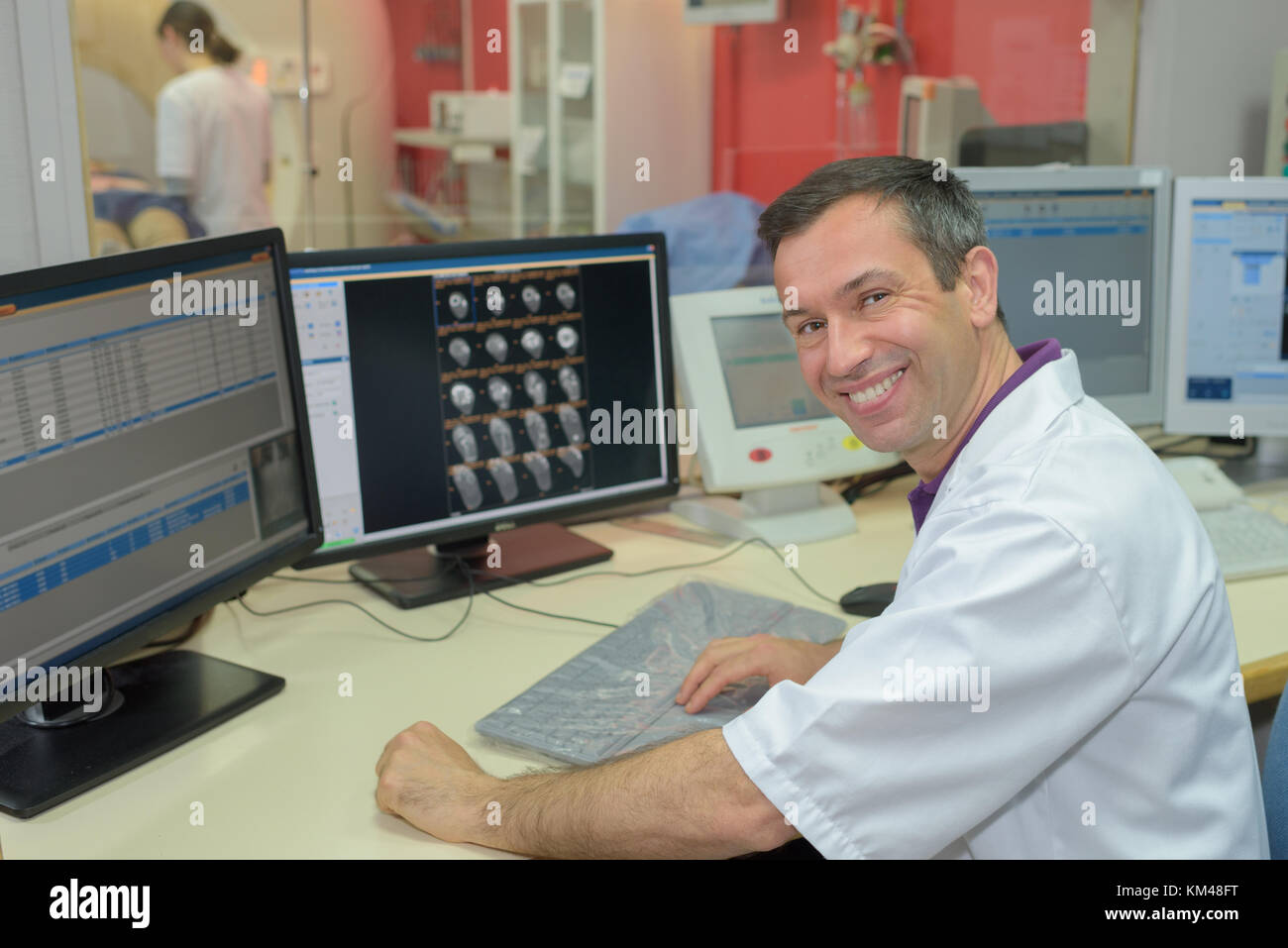 happy male hospital receptionist working