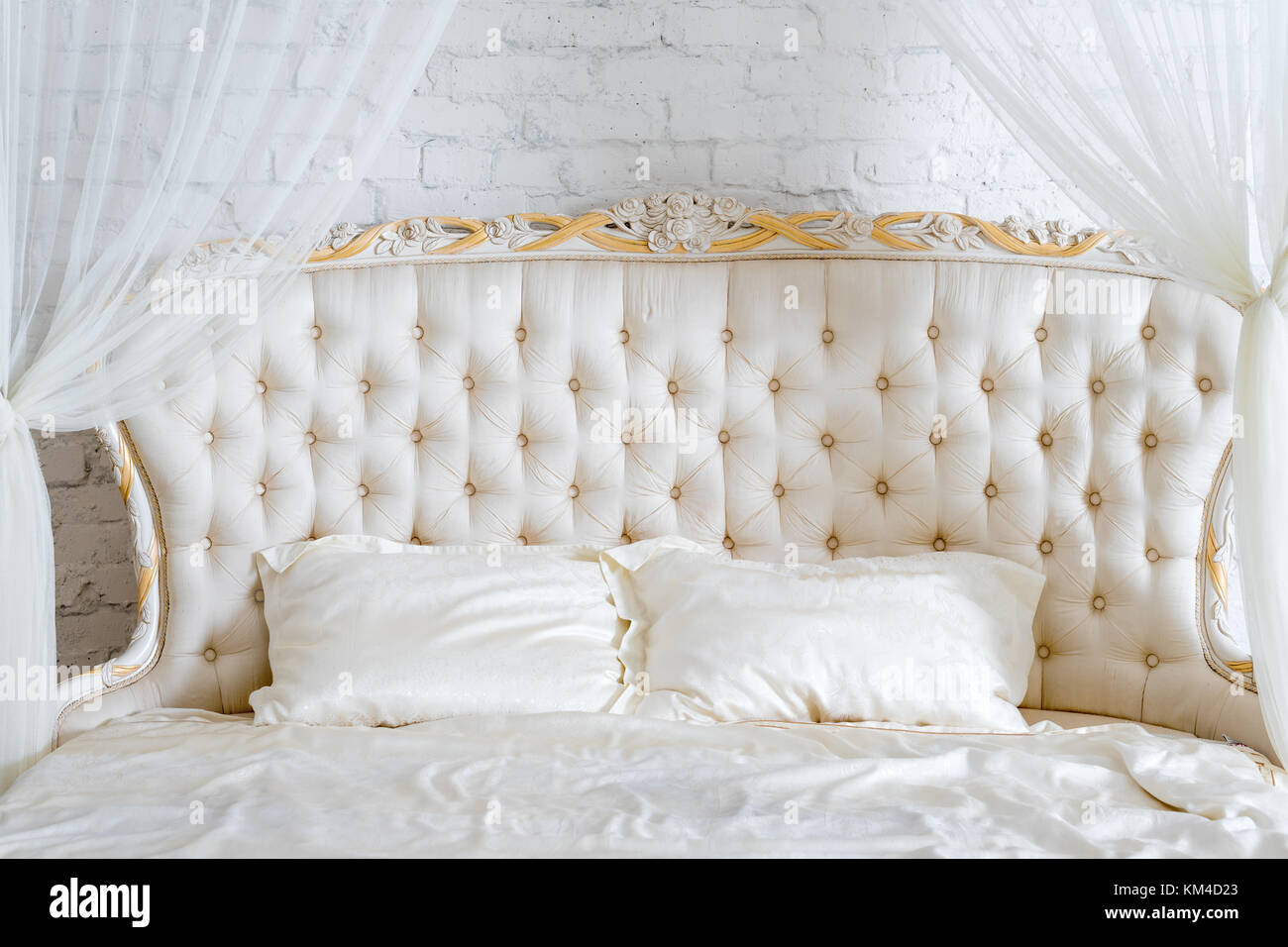 Big Comfortable Double Bed In Elegant Classic Bedroom. Luxury Elegant White  With Gold Interior Design
