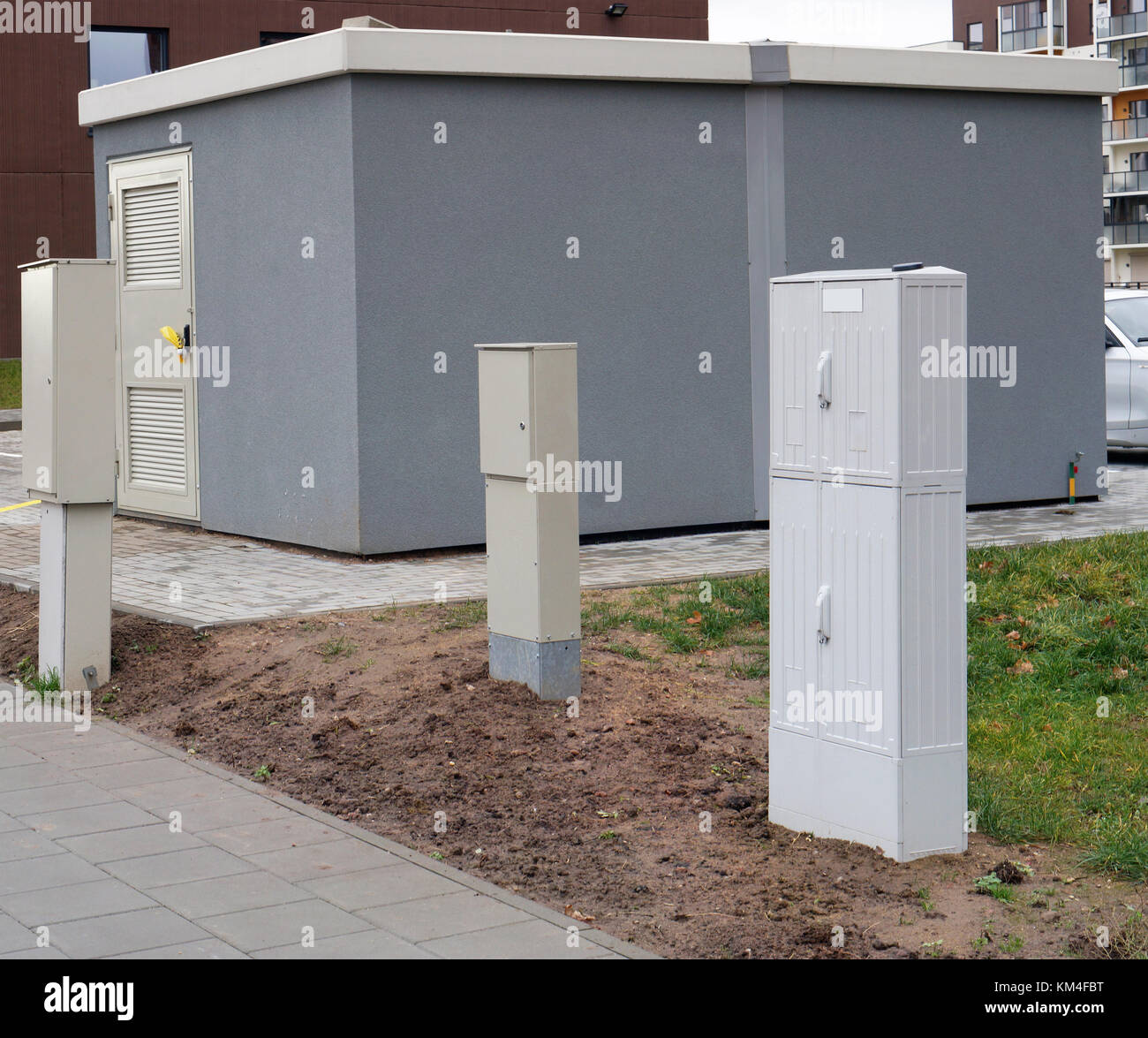 New modern transformer substation and small junction boxes in the new modern transformer substation and small junction boxes in the area of urban new buildings cloudy day panoramic collage sciox Gallery