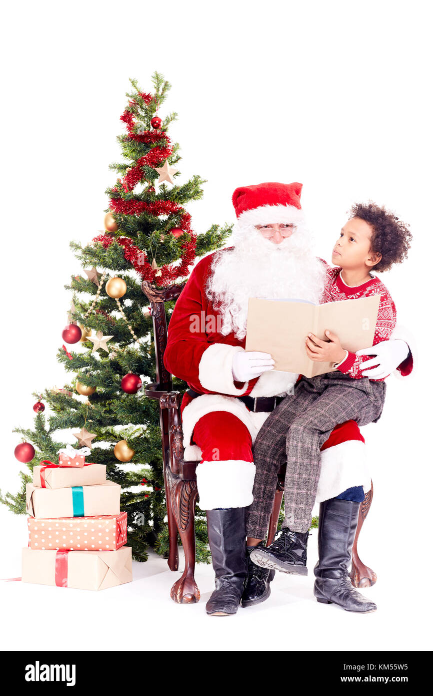 Santa reading Christmas story for kid Stock Photo: 167300817 - Alamy
