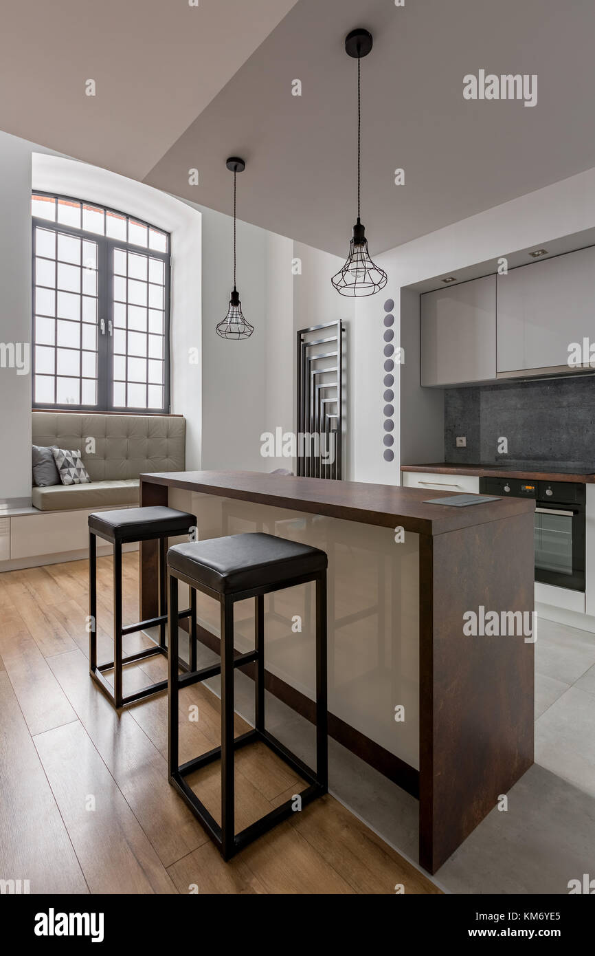Modern kitchen with big window island and simple stools
