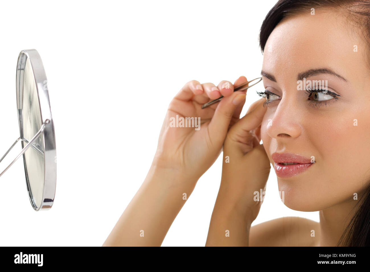 Beautiful Young Woman Plucking Eyebrows Looking At Mirror Stock