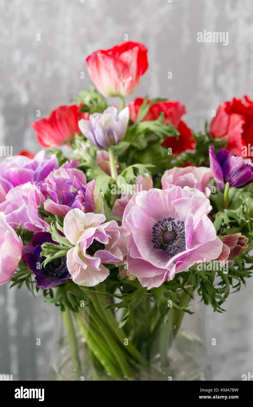 Bouquet of mixed anemones flowers in vase the work of the florist bouquet of mixed anemones flowers in vase the work of the florist at a flower shop izmirmasajfo
