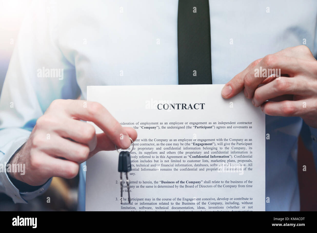 Successful Businessman Offering A Key With Contract Rental