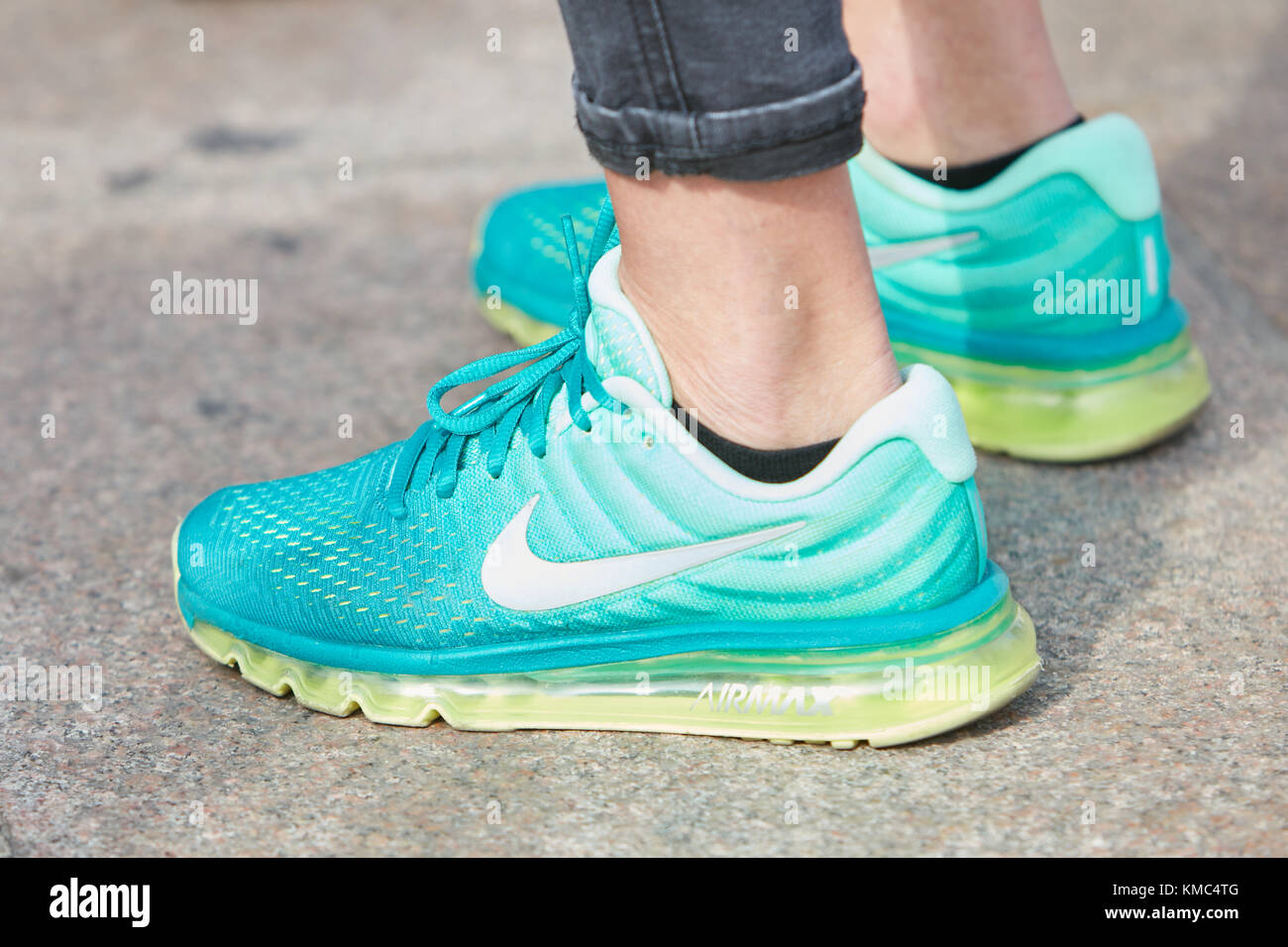finest selection ddd8e 1c426 ... new zealand milan september 23 man with turquoise nike airmax shoes  with yellow soles before gabriele