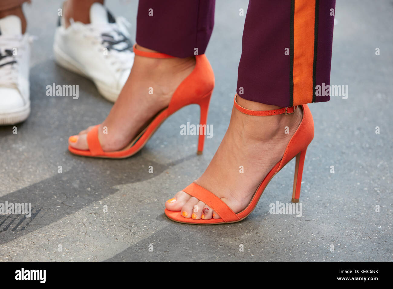 MILAN - SEPTEMBER 23: Woman with orange high heel open shoes and ...