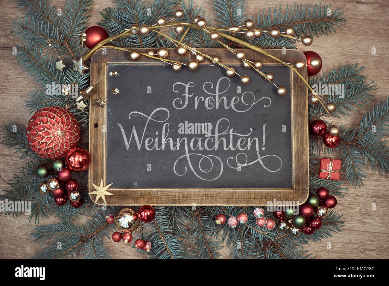 Wooden Board With Greeting Text Frohe Weihaschten Or Merry Stock